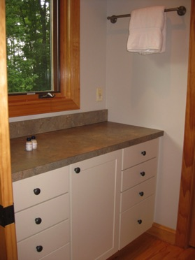 Counter across from shower (has often doubled as changing table!)